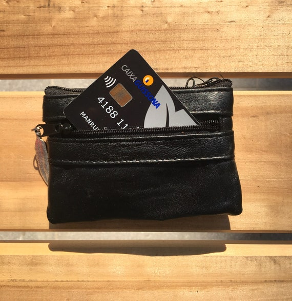 Small purse in BLACK, genuine leather, closed by 3 zippers. Fits creditcards, coins, bills. BLACK leather wallet.