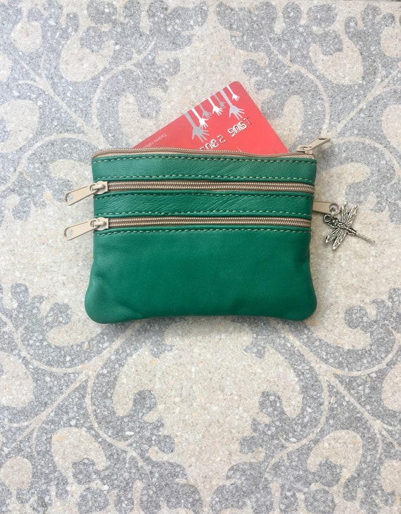 Small purse in GREEN.  Genuine leather, 4 zippers. Fits credit cards, coins, bills. Metallic GREEN leather wallet.