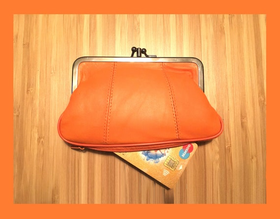 Genuine leather purse in orange with metallic wing charm. Retro purse in soft orange leather. Clasp wallet, orange leather clip purse