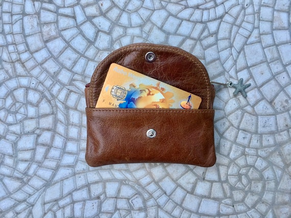Small purse in CAMEL brown  genuine leather with zippers and pocket. Fits credit cards, coins, bills. Tan or tobacco brown leather wallet
