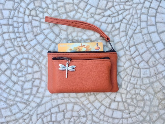 Small purse in ORANGE, genuine leather, 4 zippers. Fits credit cards, coins, bills. ORANGE leather wallet with DRAGONFLY charm
