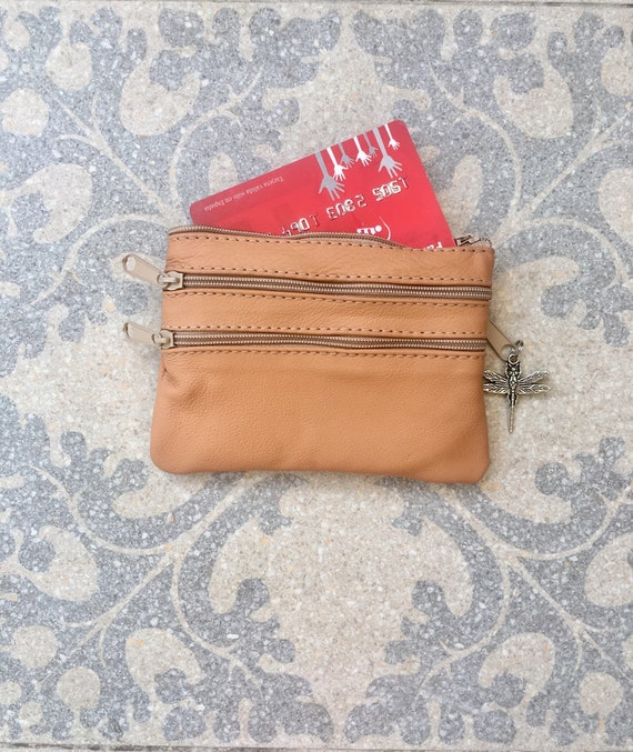 Small purse in LIGHT CAMEL.  Genuine leather, 4 zippers. Fits credit cards, coins, bills. light tobacco brown leather wallet.