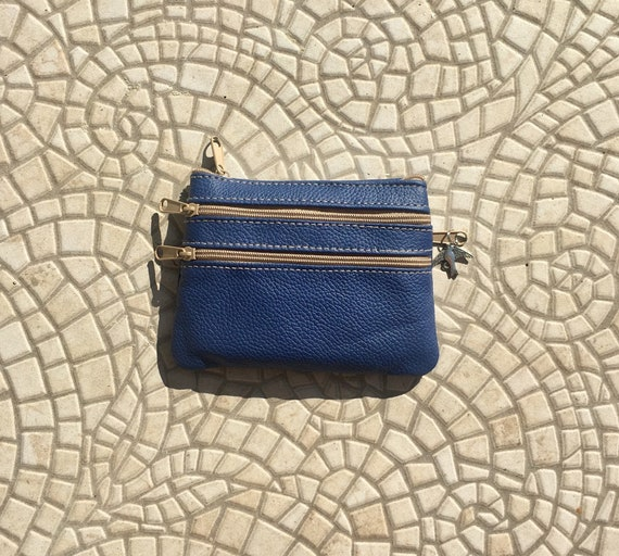 Small purse in DARK blue.  genuine leather, 4 zippers. Fits credit cards, coins, bills. Dark COBALT  BLUE leather wallet.