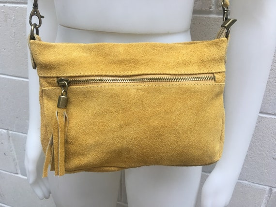 Suede leather bag in MUSTARD YELLOW .Cross body or shoulder bag in GENUINE  leather. Small  bag with adjustable strap, zippers and tassel.