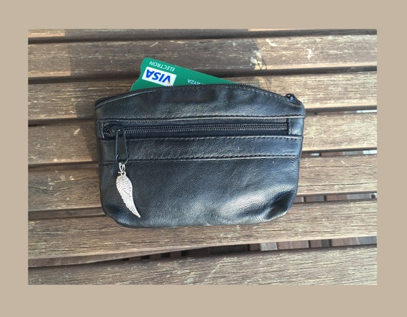 Small purse in BLACK, genuine leather,  3 zippers. Fits credit cards, coins, bills. BLACK Leather wallet