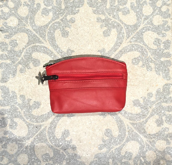 Small purse in RED , genuine leather,  3 zippers. Fits credit cards, coins, bills.Leather wallet