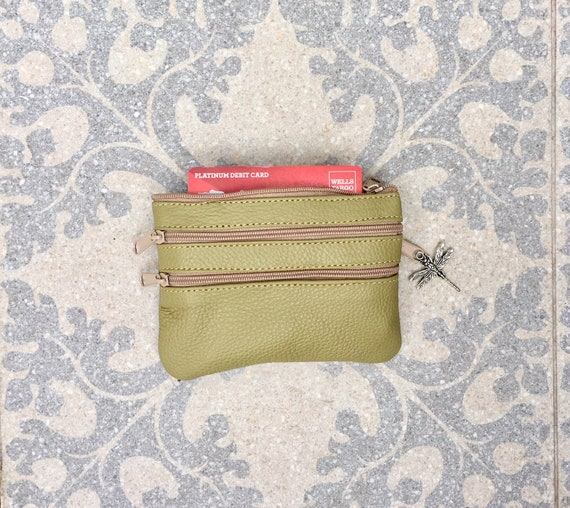 Small purse in light green, genuine leather, 4 zippers. Fits credit cards, coins, bills. Light green leather wallet with DRAGONFLY charm
