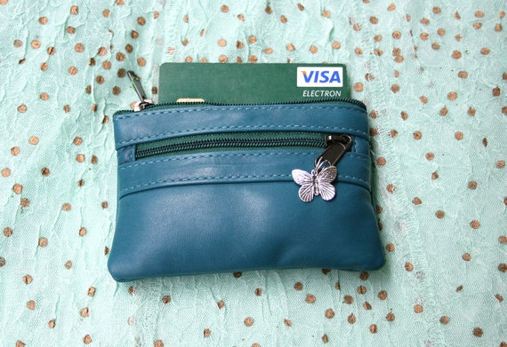 Coin purse in blue. Small zipper purse for credit cards, coins, bills etc. Genuine leather, 3 zippers and butterfly metallic charm.
