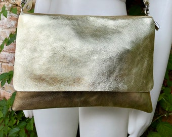 Genuine leather bag in GOLD. Cross body bag or shoulder bag in metallic shine leather. Adjustable strap, zipper and flap.Glitter leather bag