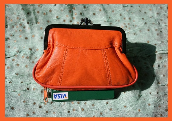 Vintage style small clip purse in genuine leather. Orange clip wallet for coins, notes and separate zipper for credit cards.