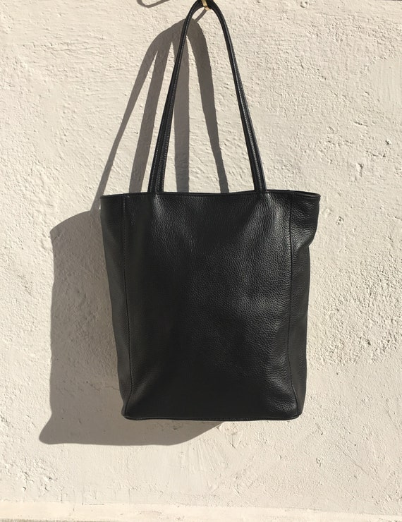 NEW with zipper and lining. Tote leather bag in BLACK . Soft GENUINE  leather bag. Large black bag .Laptop or book bag. Black  tote
