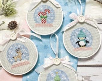 New! PRIMROSE COTTAGE STITCHES White Christmas counted cross stitch patterns at thecottageneedle.com