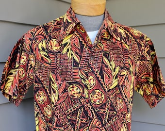vintage 1940's 'Paradise Sportswear' Men's Hawaiian shirt.  Bold tribal print w/ Monstera leaves - Orange, Yellow, & Brown - Cotton. Medium