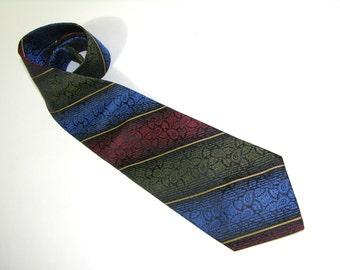 vintage 70's - 80's -Rapheala- Men's neck tie. Diagonal repp stripes in electric Paisley. All Silk. USA