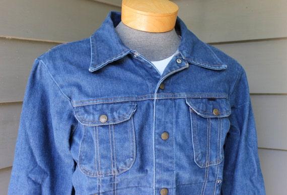 vintage 1960's Men's 4 pocket denim jacket by KEY. Action back Side buckle adjustment. Washed & worn to perfection. Size 42