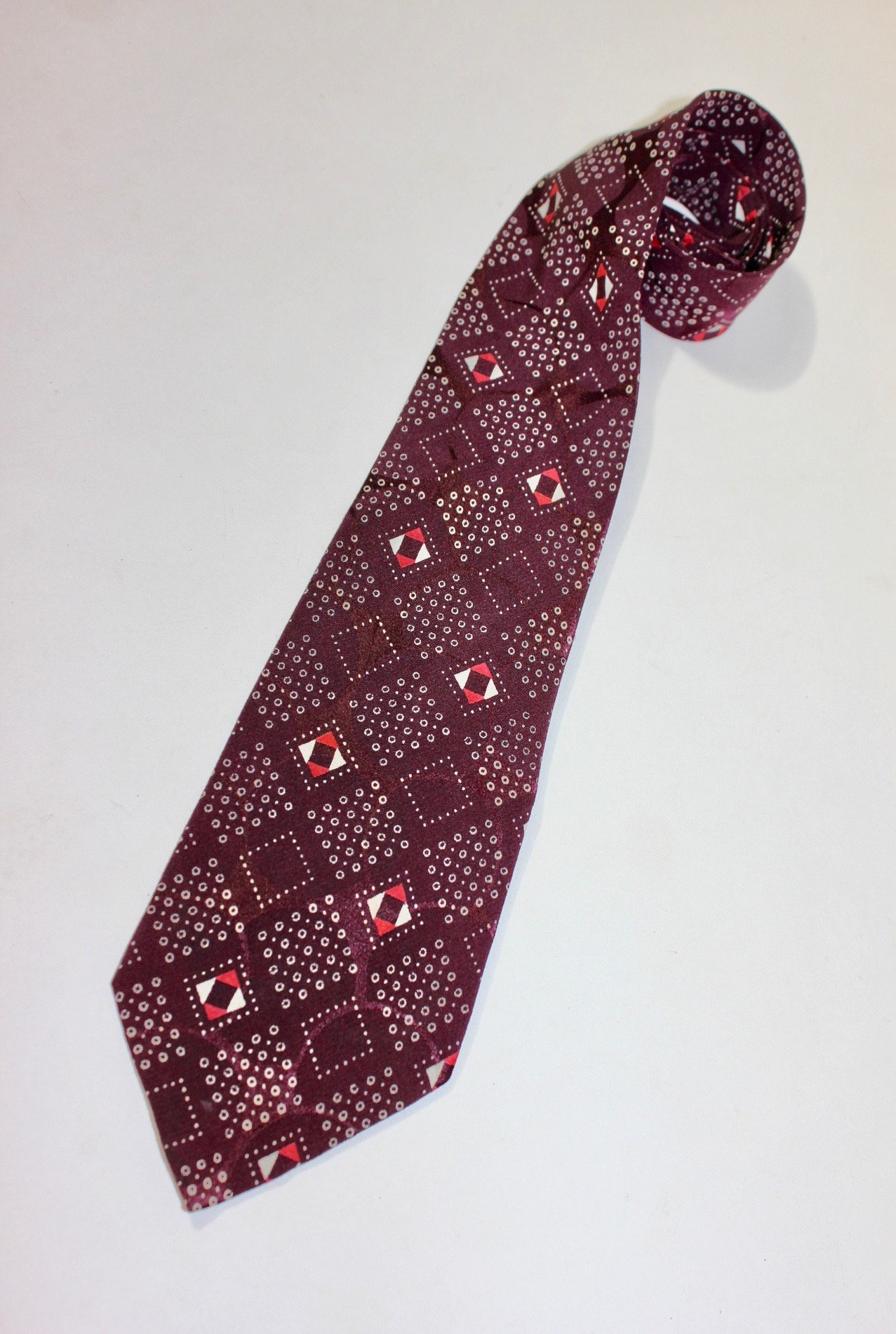 New 1930s Mens Fashion Ties Vintage 1930s -Sulka - Mens 4 Fold Neck Tie. Burgundy with Red  White Geometric Harlequien Design. Circular Ghost Pattern. 3 38 Wide $6.50 AT vintagedancer.com