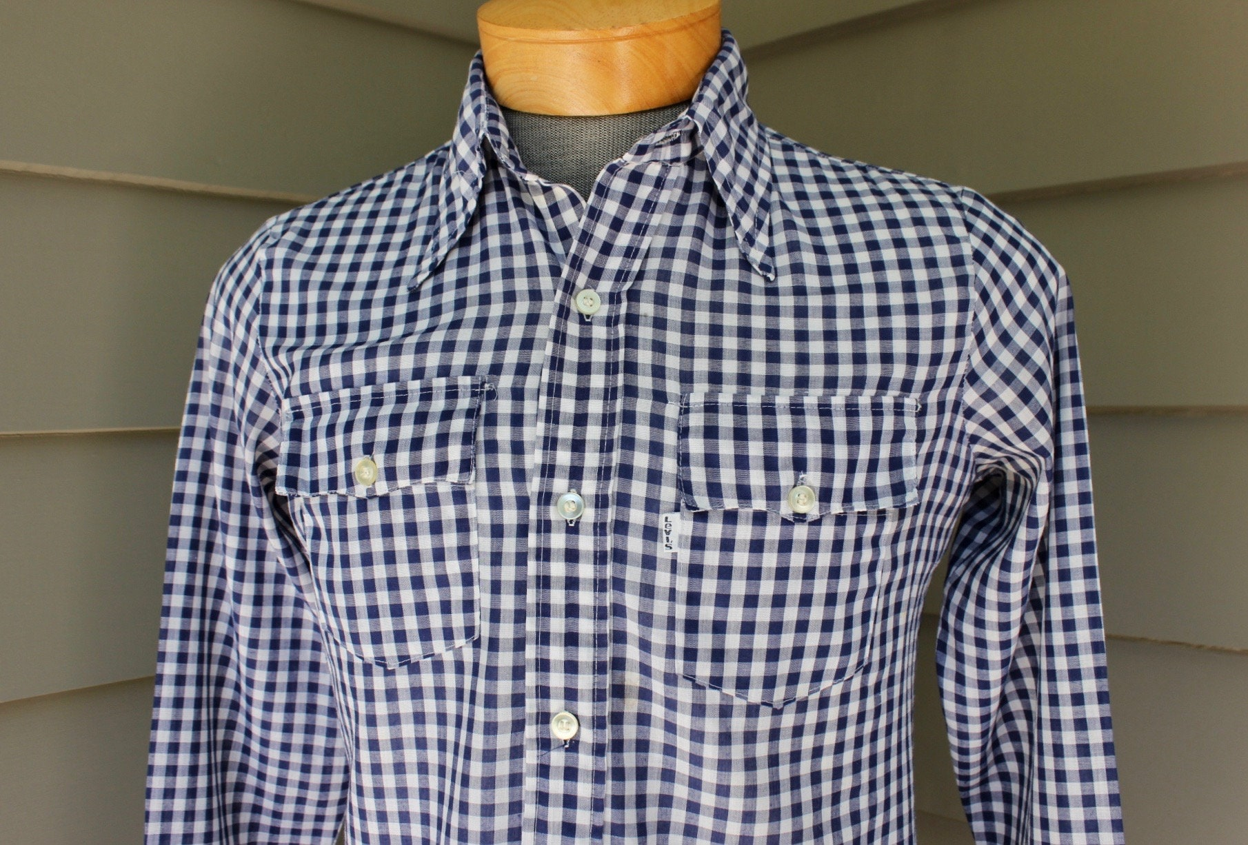 1970s Men's Shirt Styles – Vintage 70s Shirts for Guys Vintage 1970s -Levis- Mens Long Sleeve Shirt. Blue Gingham Check. White Tab Labeling. Spear Point Collar - Flapped Pockets. Small $41.79 AT vintagedancer.com
