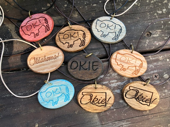 Wooden Oklahoma pendants on leather cording necklaces