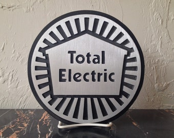 Total Electric Wall Plaque