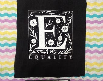 EQUALITY E Patch like the alphabet but also like that thing we need way more of in our stupid society