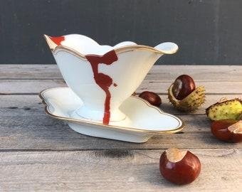 "Sauciere ""Blood"", ø approx. 21 cm, vintage porcelain with gold rim, handmade screen print motif;"