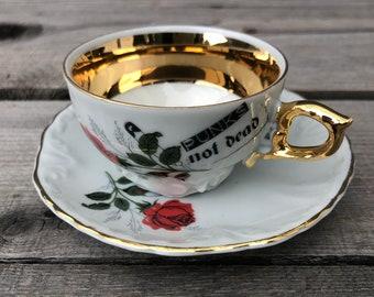 "Mokka/Espressocup ""Punks not dead"", porcelain, 2 pcs., floral decor, goldrim and handscreen printed motifs"