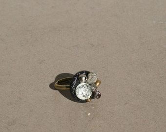 Ring with beads on old vintage button