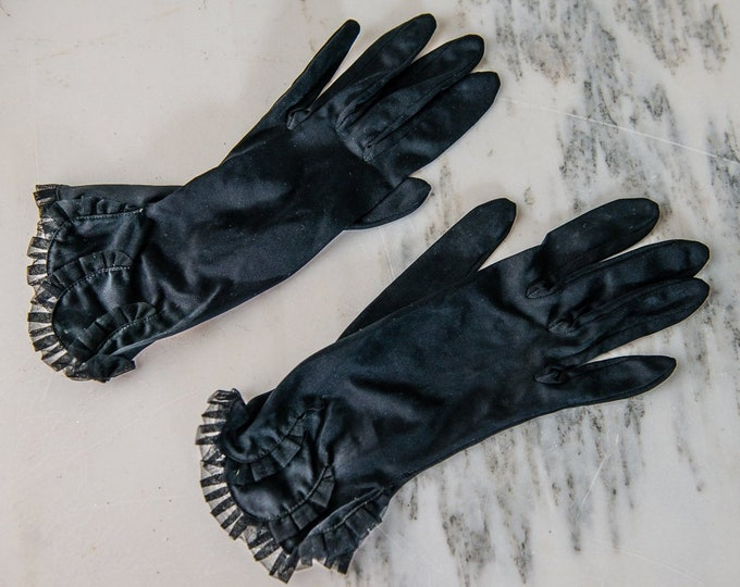 Vintage 1950s black nylon formal dress gloves with ruffled wrist details | Size M