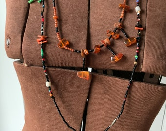 Vintage handmade extra long black multi-color seed bead necklace with amber beads, coral and a wooden fish, boho jewelry