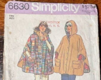 Vintage 1970s Simplicity sewing pattern 6630 for misses jiffy Reversible hooded poncho, One Size