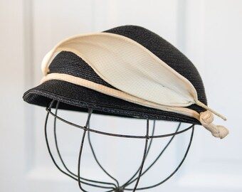 Vintage 60s black and white woven pillbox hat with fabric feather detail, Draper New York, Taylor's Cleveland OH