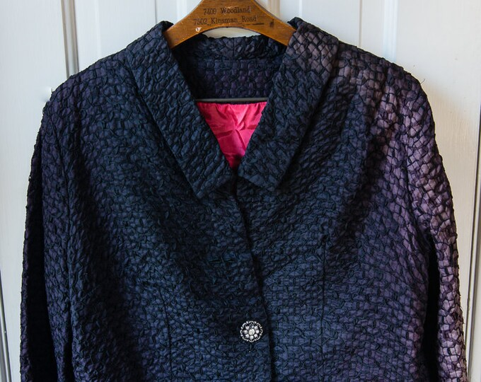 Vintage 1950s boxy black textured suit jacket with hot pink lining and decorative bow | **needs love** | Size L/XL