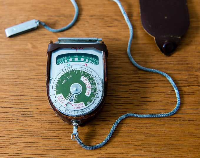 Vintage Alpex exposure meter or light meter Model 700539 with leather case and chain clip