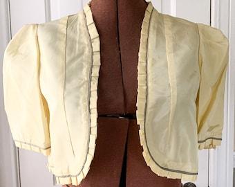 Vintage 1950s yellow taffeta short sleeve bolero style jacket or shrug with ruffles gray/green piping | Size S