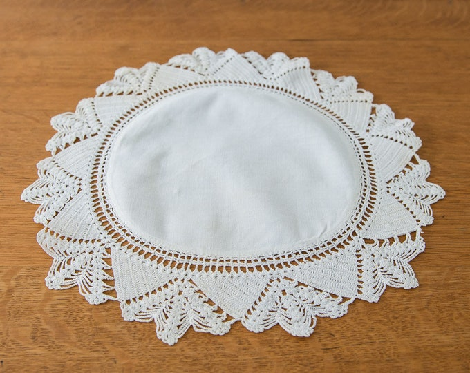 Vintage round white linen doily with hand-crocheted lace edging