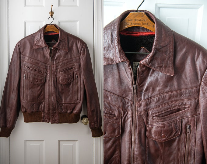 Vintage 70s reddish brown leather jacket with knit banded waistband and cuffs, Size M