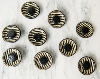 Vintage 1940s lot of 9 metal Art Deco striped and cup-shaped black and off-white shank buttons