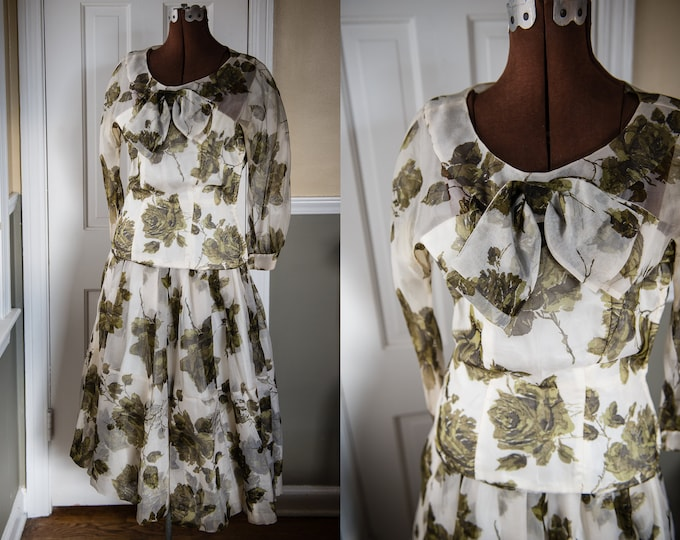 Vintage 1950s 2 piece silk skirt and blouse in white with green rose motif and large bow at the neckline | Cadillac Original | Size XS/S