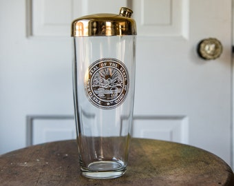 "Vintage glass cocktail shaker with gold ""The Great Seal of the State of Ohio"" insignia and top 