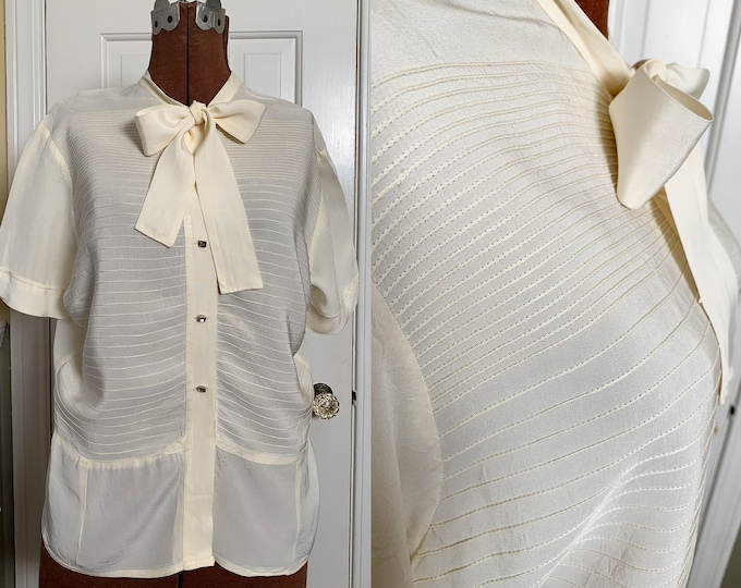 Vintage 1950s cream color secretary blouse with bow tie collar and rhinestone buttons | Tailored by Adelaar | Size L