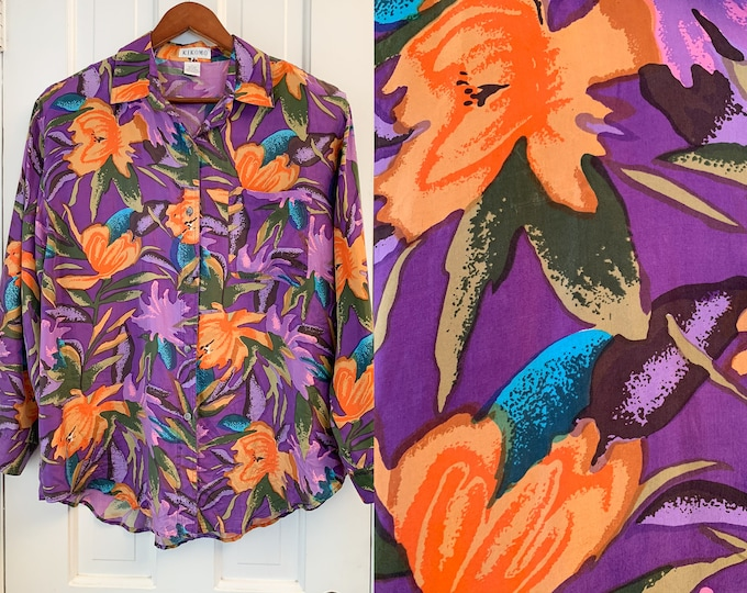 Vintage women's silk long sleeve button down blouse in bold purple and orange floral print, Kikomo, Size L