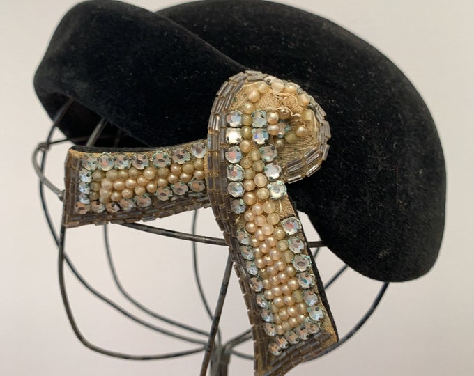 Vintage 1950s black pillbox hat with elaborate ribbon decoration rhinestones bugle beads and faux pearls, 50s fashion hat, made by Opera