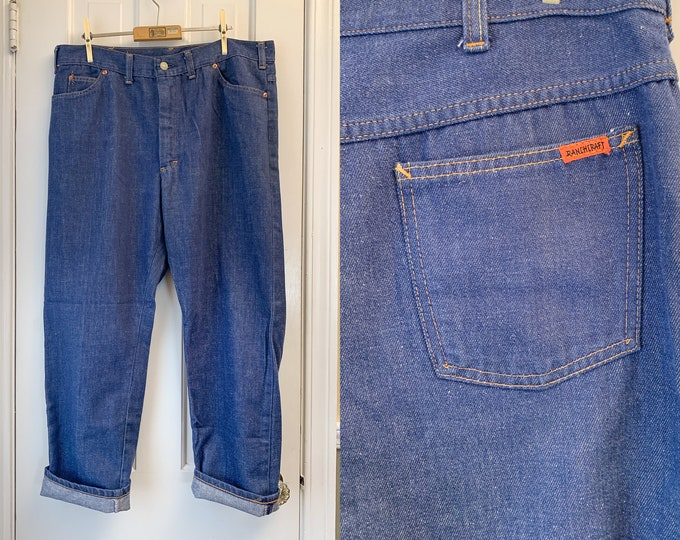 Vintage 1970s dark denim jeans, high rise workwear denim pants, made by Ranchcraft, size 36