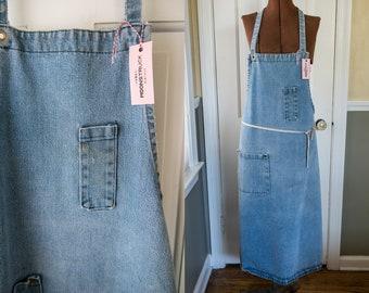 Vintage distressed denim workwear apron with riveted pockets and pockets | craftsperson artist apron