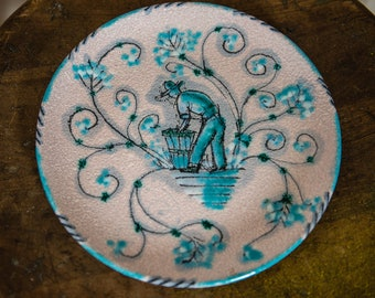 Vintage ceramic pottery plate hand decorated with harvest farmer motif