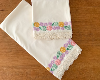 Pair of vintage cream colored hand-embroidered cotton pillowcases with flower garland design, standard size, farmhouse decor
