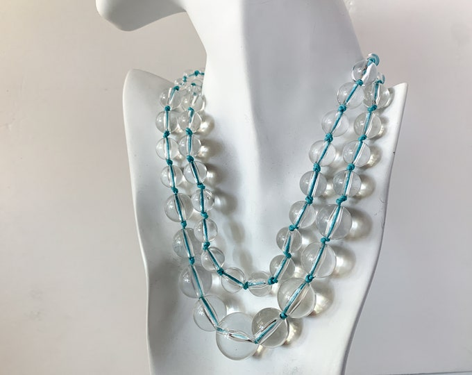 Vintage mod double strand clear plastic graduated bead necklace strung on sky blue string