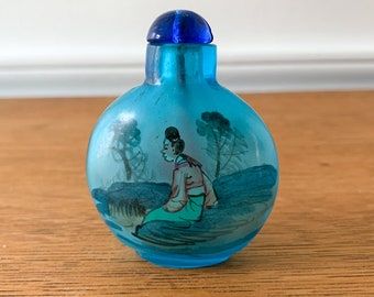 Vintage Asian blue glass snuff box with traditionally dressed figures, snuff bottle, Japanese collectible