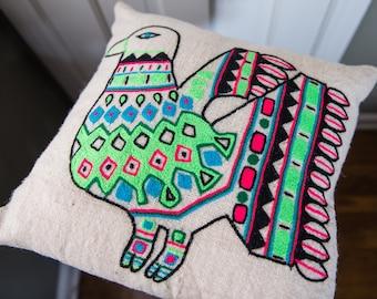 Vintage 1980s crewel embroidered linen throw pillow with primitive bird motif