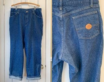 Vintage dark denim work jeans, high rise workwear denim pants, made by Red Kap, size 36